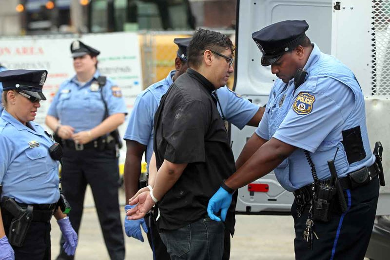 The Rev. Adan Mairena, pastor at West Kensington Ministry, is arrested by Philadelphia police on Tuesday after he and three other immigration protesters blocked traffic for over an hour over the Supreme Court ruling on immigration.